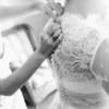 Buttoning up wedding dress | Rayan Anastor Photography | Traverse City Wedding Photographer