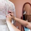 Buttoning up wedding dress | Rayan Anastor Photography | Michigan Wedding Photographer