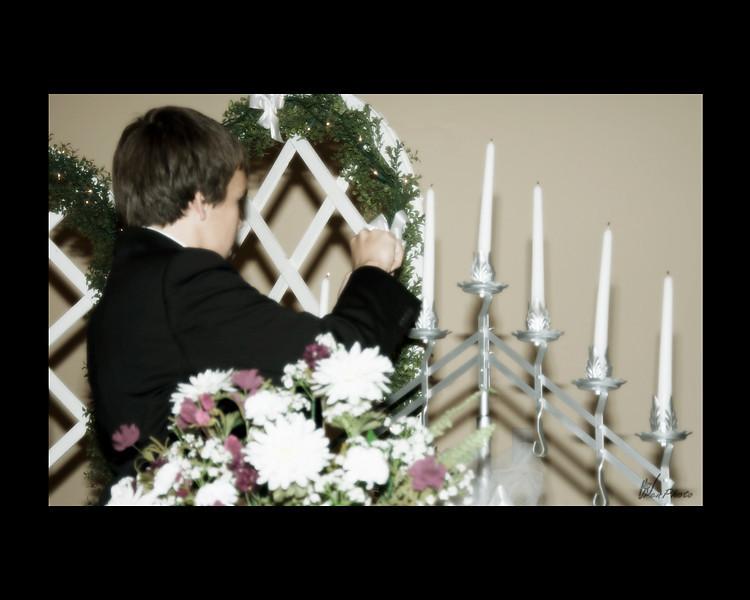 Adam lights the candles
