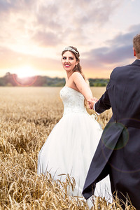 Bride and Groom Running at Sunset Through a Corn Field