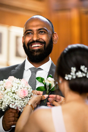 Smiling Groomsman as his Floral Button Hole is Adjusted