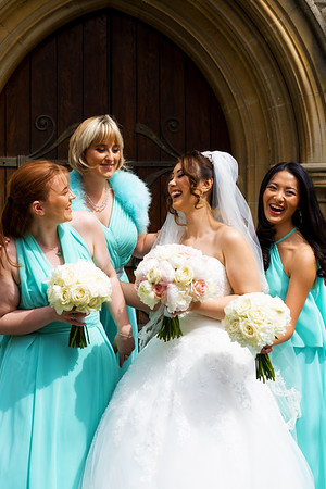 Bride and her Bridesmaids Share Laughter