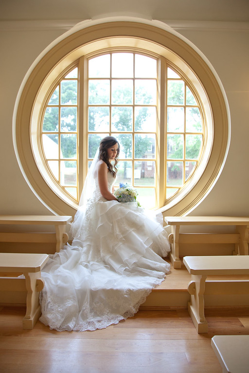 The famous round chapel windows at the American Village Chapel, a gorgeous venue for weddings. Daniel Taylor Photography