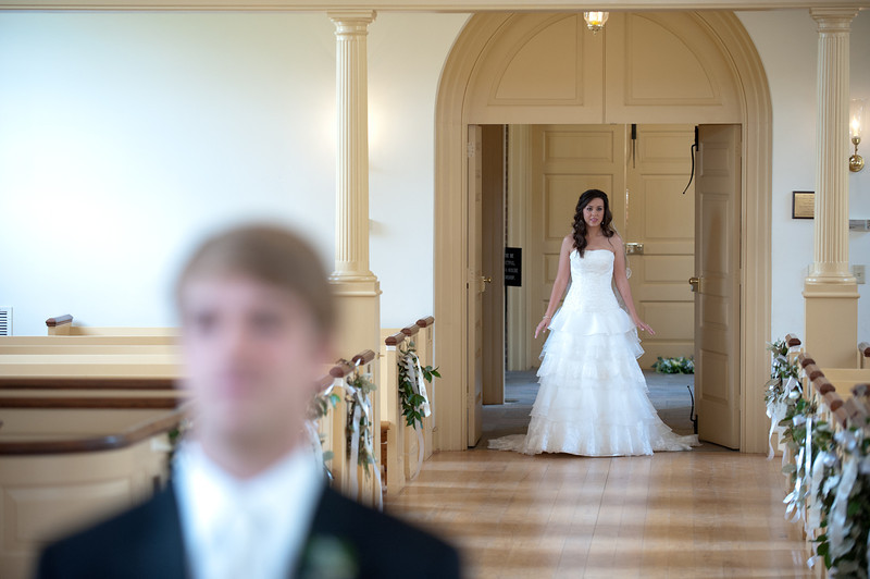The pre-wedding first look in the American Village chapel. Daniel Taylor Photography