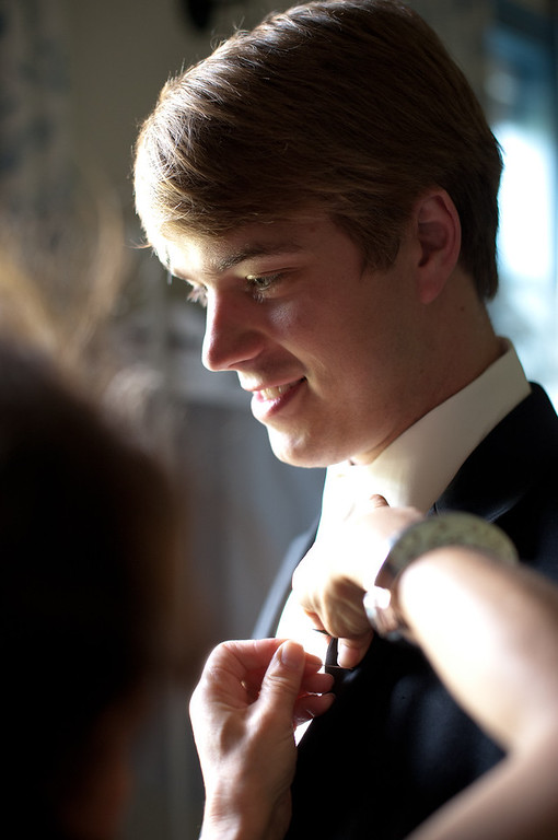 Groom ben gets his boutonniere put on. Florals by Lillie's. Daniel Taylor Photography at American Village.