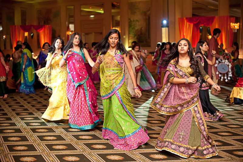 "Wedding guests dance ""garba"", a traditional folk Gujurati dance. Daniel Taylor Photography"