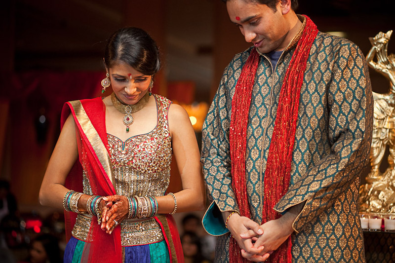 The bride- and groom-to-be bow their heads, showing their respect and asking for blessings during this traditional Hindu engagement ceremony at the Wynfrey Hotel. Daniel Taylor Photography