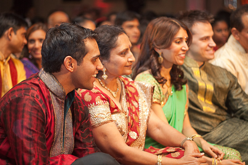 The groom's family smiles during the Hindu engagement ceremony at the Wynfrey Hotel. Photo by Daniel Taylor Photography.