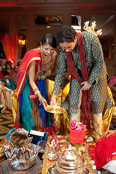 """'The bride- and groom-to-be perform """"aarti"""", a traditional part of many Hindu ceremonies sung at the end of the pooja (prayer). Daniel Taylor Photography"""