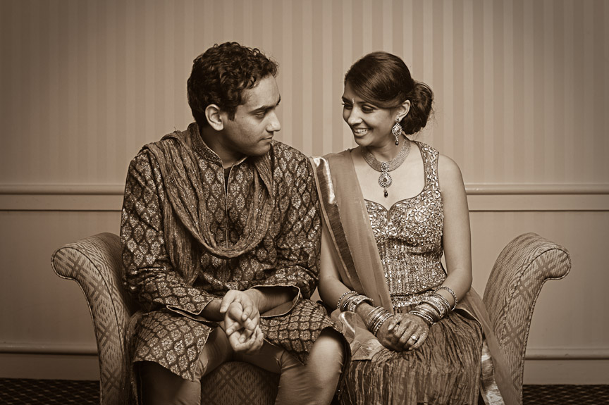The bride- and groom-to-be share a quiet moment before all the festivities start. Hindu engagement ceremony at the Wynfrey Hotel in Birmingham, Al. Engagement photography by Daniel Taylor Photography.