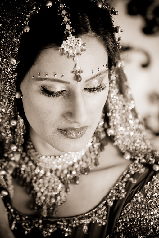 Sepia brown towns are gorgeous for Indian weddings. Photo by Kelli + Daniel Taylor Photography