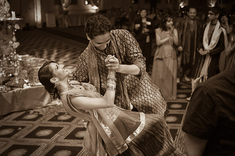 A dip during the Hindu engagement party at the Wynfrey Hotel in Birmingham, Ala. Photo by Daniel Taylor Photography.