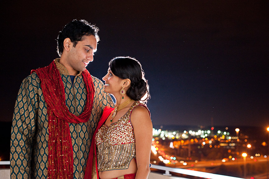 The bride- and groom-to-be share a moment with a gorgeous Birmingham background at the Wynfrey Hotel during their engagement ceremony. Engagement photography by Daniel Taylor Photography.