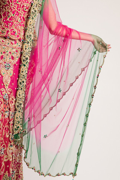 Jaw-dropping pink and green wedding reception lengha. Kelli + Daniel Taylor Photography