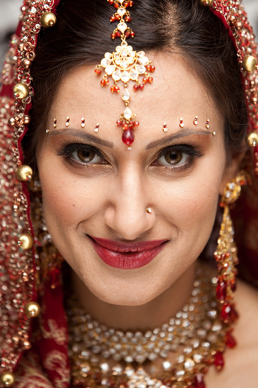 Beautiful Indian bride in red and gold. Kelli + Daniel Taylor Photography