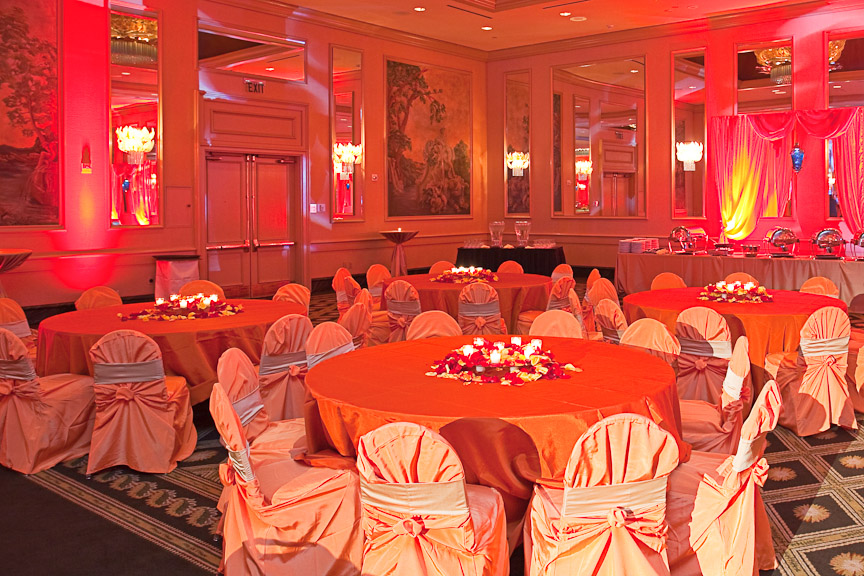 The Wynfrey Hotel ballroom, drenched in orange, gold and red for the gorgeous Hindu engagement. Photo by Daniel Taylor Photography