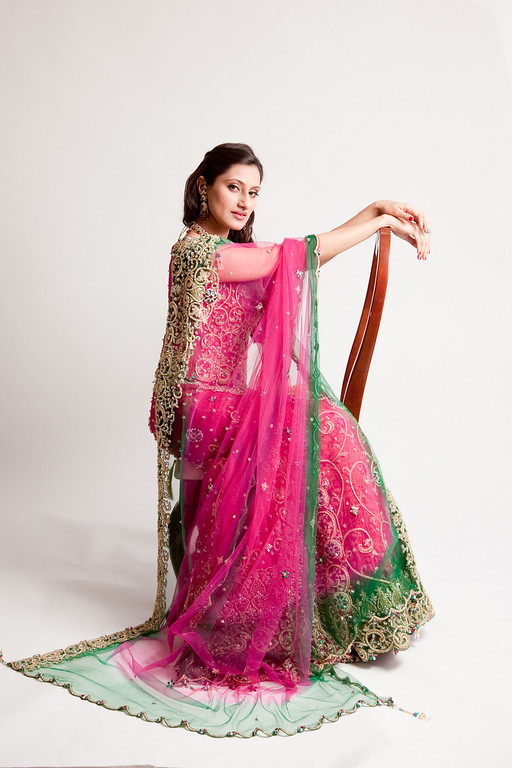 A pose bride B.M. found in an Indian wedding magazine, showing off her pink and green wedding reception lengha. Daniel Taylor Photography