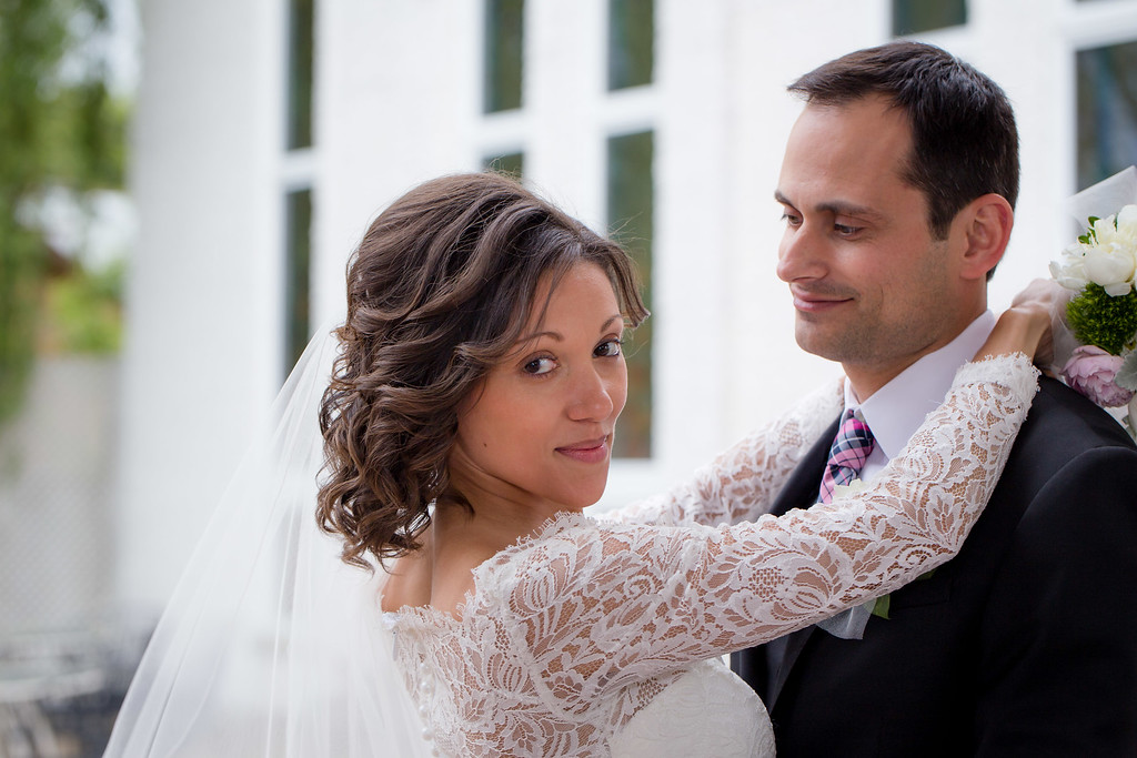 Gorgeous bride and groom photographed in the courtyard of Saint Sophia Bulgarian Church, Des Plaines, IL