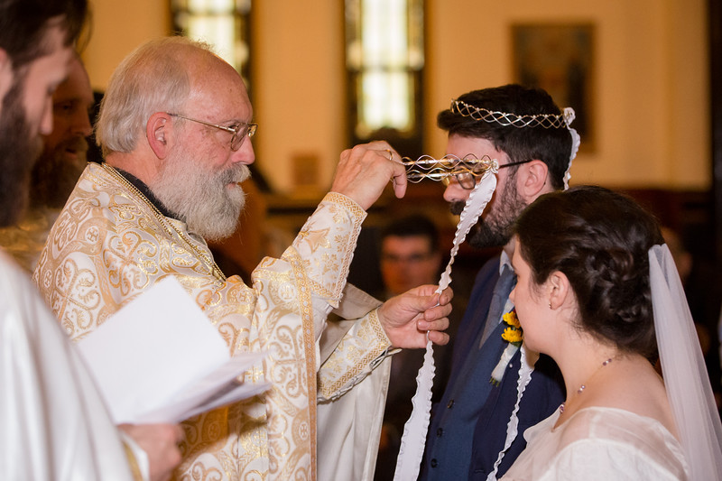 Love couple getting married at Joy of All Who Sorrow Eastern Orthodox Church, Indianapolis, IN
