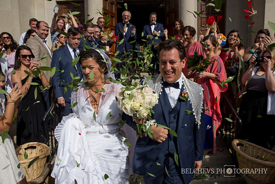 Newly weds greeted by rose petals and basil leaves (very symbolic), right outside All Saints Greek Orthodox Church, Joliet, IL.