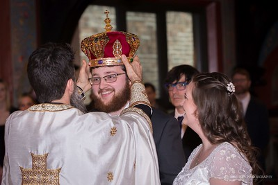 The orthodox wedding service is long, beautiful, and smile-worthy. Photographed at Christ the Savior Orthodox Church in downtown Chicago, IL.