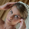 The bride adjusting her tiara while getting ready for her wedding ceremony at Caracoal Che in Rincon, Puerto Rico.