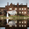 Goom and Bride with  Veil Blowing in the Wind