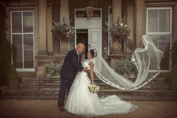 wedidng couple out side Hothorpe Hall