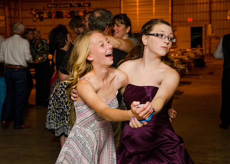 Loehrs wedding bridesmaid with friend dancing
