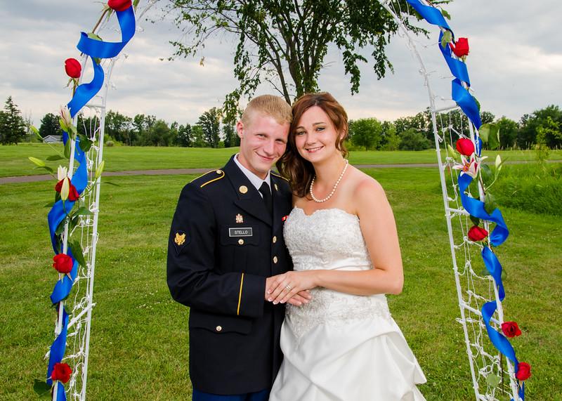 Stello wedding bride and groom under trellis