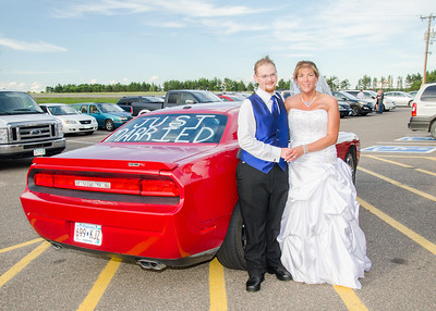 Bride and groom with dodge challenger