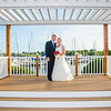 Jackson wedding bride and groom by harbor