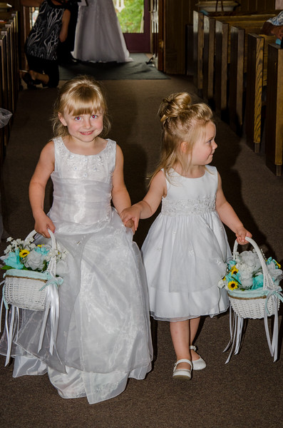 Holt wedding flower girls in isle