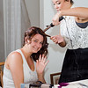 Stello wedding bride doing her hair in curls