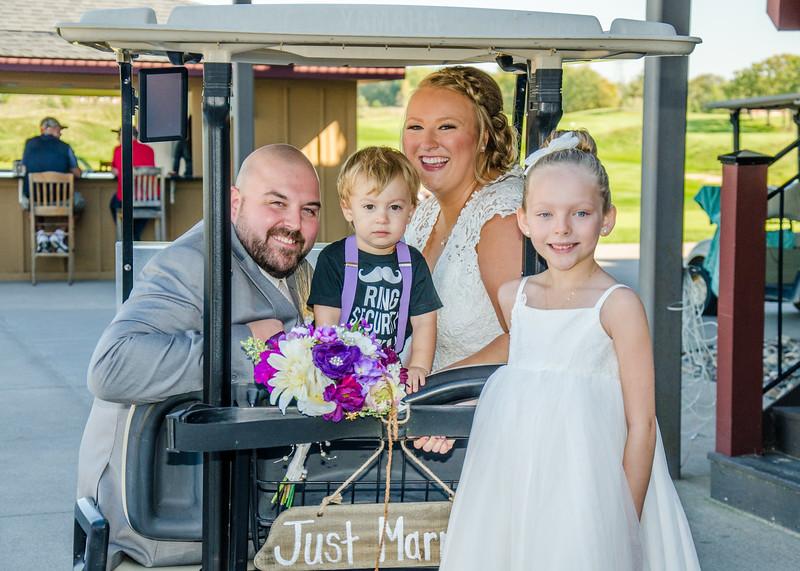 Riess wedding bride and groom on golf cart