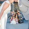 Riess wedding party under bride and groom