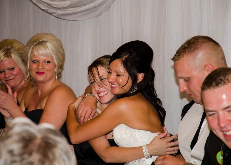 Risa wedding bride hugging sister
