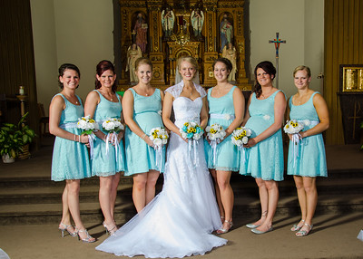 Bride with Bridesmaids at alter