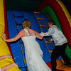 Loehrs wedding bride and groom in bouncy house
