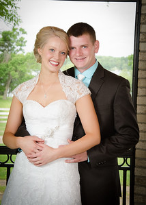 Bride and groom in farmhouse porch