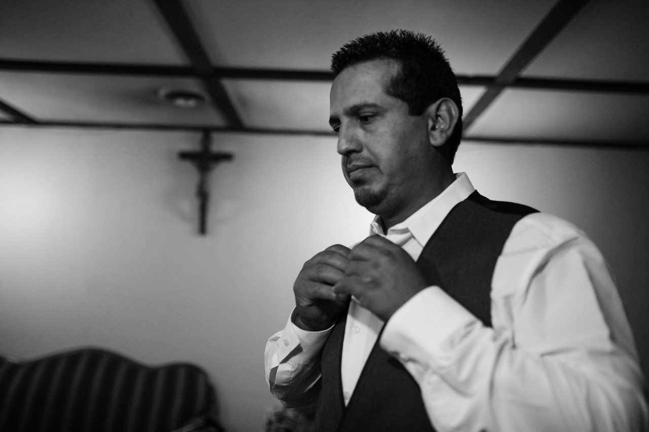 Preparations and pre-ceremony photography for Erika & Raul's wedding at Saints Peter & Paul Catholic Church in Rockford. Wedding photographer – Ryan Davis Photography – Rockford, Illinois.
