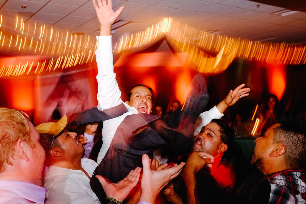 Erika & Raul's wedding reception at IBEW hall in Rockford, IL. Wedding photographer -Ryan Davis Photography – Rockford, Illinois.