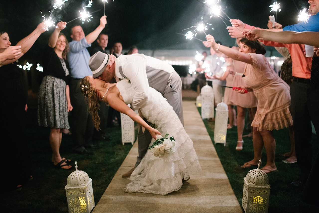Outdoor wedding reception under a tent at Oak Hill Weddings in Apple River,  near Galena and Dubuque– Ryan Davis Photography – Rockford, Illinois.