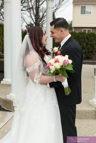 Bride and groom looking into each others eyes