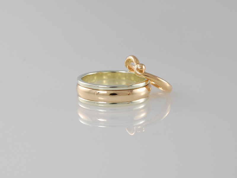 "Our gold ""Baku"" design wedding band with ""Port Louis"" shaped band in gold"