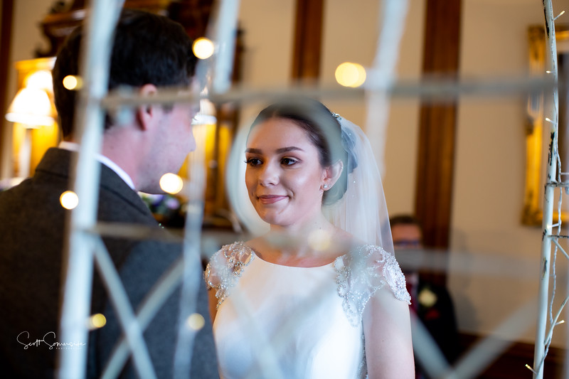 Phoebe through the sparkly arch at Merewood Country House Hotel wedding