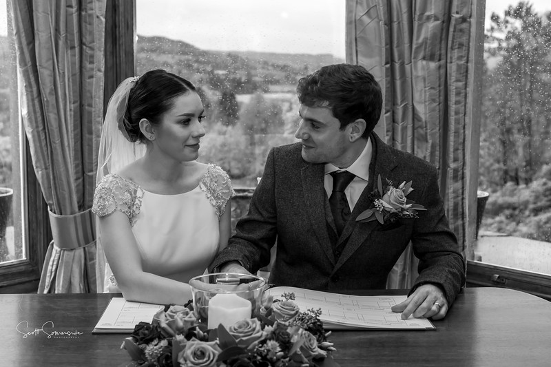 Phoebe and Jay signing the register  at Merewood Country House Hotel wedding
