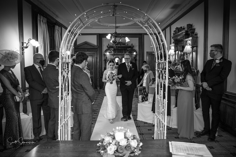 Phoebe walking down the aisle at Merewood Country House Hotel