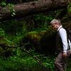 engaged couple explore lush green woodland together