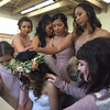 Mae being prayed over by her bridesmaids.